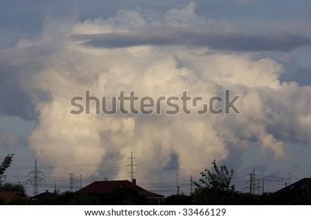 Dark cloud above city, ecology
