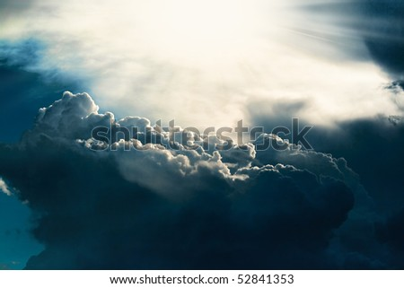 Dark cloud on sky with sun light beams
