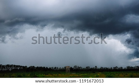 Dark cloud sky and raining in field #1191672013