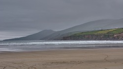 Dark clouds above Inch Beach, Irleand. Panoramic seascape in Ireland. Stormy day at the sea at Inch Beach, Ireland.
