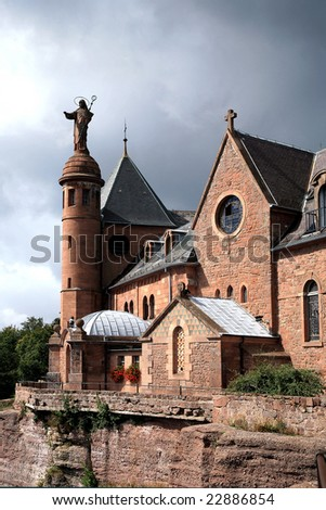 Dark clouds after storm above Mont Sainte-Odile Abbey in Alsace, France. Vosges Mountains.