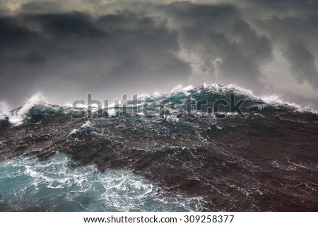 Dark clouds and crashing ocean waves during storm in the atlantic ocean