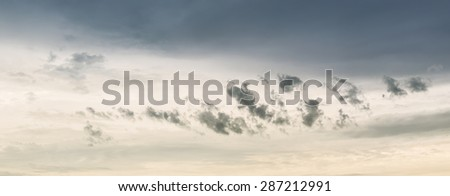 Dark clouds and sunlight in sky after a big storm in panoramic view.