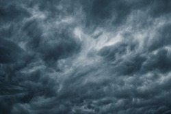 Dark clouds before a thunder-storm, Dramatic storm cloud sky background, Atmosphere environment and climate weather background.