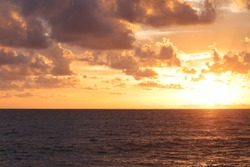 dark clouds on the glowing sky at sunset. dramatic nature scenery on the windy weather in evening.Beautiful sunset above the sea.Dramatic sunset and sunrise sky.Fiery orange sunset sky. Beautiful sky.