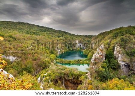 Dark clouds over a beautiful autumn view of Plitvice national park in Croatia, a UNESCO world heritage site