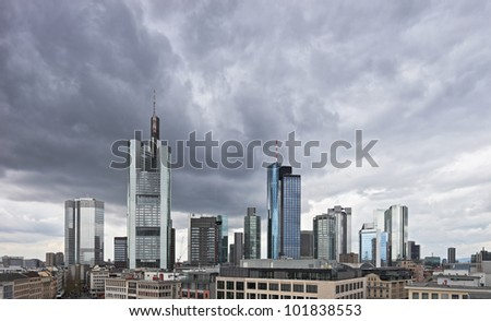 Dark clouds over the financial centre in Frankfurt, Germany. Most of the buildings in this region are the headquarters of businesses and corporations