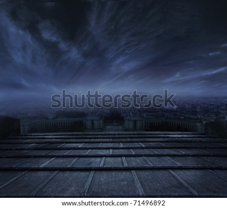 Dark clouds over urban background