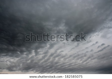 Dark clouds. The stormy clouds over horizon.