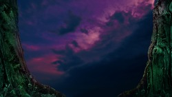 Dark cloudscape framed by old scary trees. Mysterious fantasy landscape with purple indigo sky