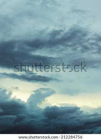 Dark cloudy sky, rain clouds - vertical format
