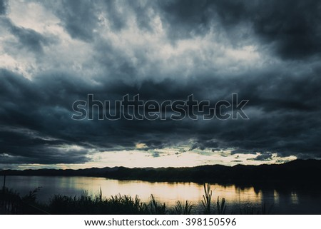 dark cloudy storm river view.