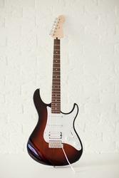 Dark colored stratocaster electric guitar