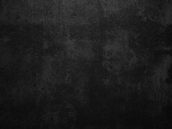 Dark concrete texture wall background. Black grunge cement wall texture for interior design. Copy space for add text.