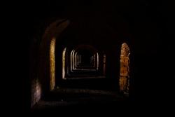 Dark corridor in abandoned factory. Urban exploration.