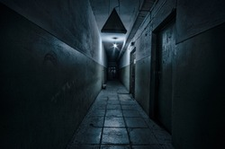Dark corridor. Mystical interior of dark empty corridor, tunnel in an abandoned house. Dark mysterious corridor. The interior of an abandoned house, road to hell. An old abandoned building