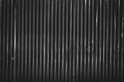 Dark corrugated metal or zinc texture surface or black galvanize steel industrial texture and background.
