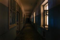 Dark creepy corridor of abandoned hospital at night. Horror concept.