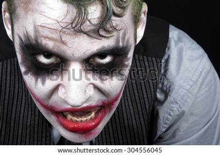 Dark creepy joker face screaming angry