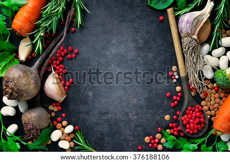 Dark culinary background with fresh farm vegetables, top view #376188106