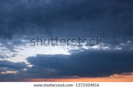 dark, dark clouds of our world