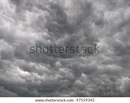 Dark, dense and magnificent, gray storm clouds