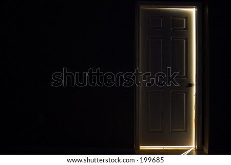 dark door with glow behind