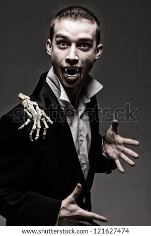 Dark dramatic portrait of the real young vampire
