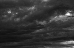 Dark dramatic sky and clouds. Background for death and sad concept. Gray sky and fluffy white clouds. Thunder and storm sky. Sad and moody sky. Nature background. Dead abstract background. Cloudscape.