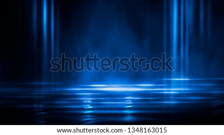 Dark empty scene, blue neon searchlight light, wet asphalt, smoke, night view, rays.