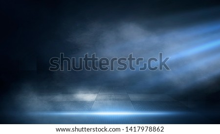 Dark empty scene, blue neon searchlight light, wet asphalt, smoke, night view, rays. Empty black studio room. Dark background. Abstract dark empty studio room texture.  Product showcase spotlight back