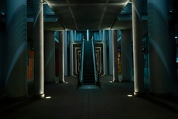 Dark escalators light with neon and led lights