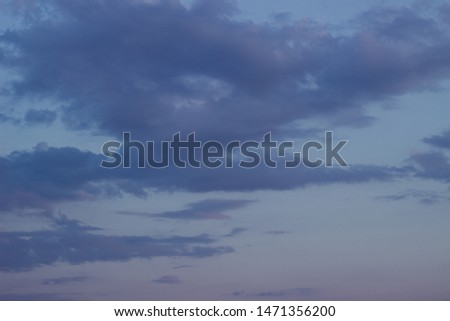 Dark evening sky purple with feathery clouds, texture