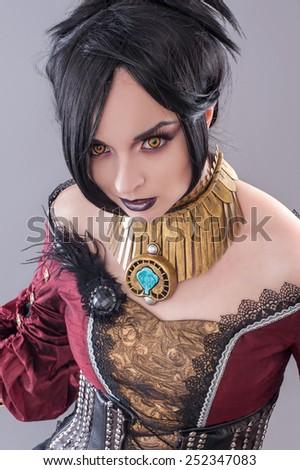 Dark gothic woman. Sexy gothic woman posing in studio.