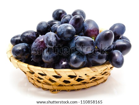 Dark grape in the basket isolated on a white