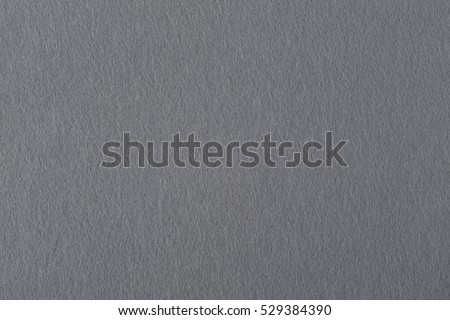Dark gray felt texture. High resolution photo.