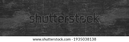 Dark gray grey anthracite black scratched damaged slate, shale natural stone concrete texture background banner panorama