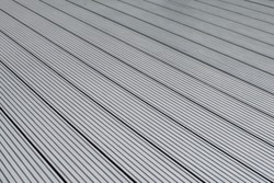 Dark gray or anthracite wpc material composite board deck for the construction of terrace.