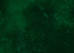 Dark green abstract textured background texture to the point with spots of paint. Blank background design banner.