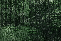 Dark green and olive fluffy background of soft, fleecy fabric. Texture of emerald velveteen textile backdrop with shiny pattern, closeup.