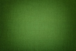 Dark green background from a textile material with wicker pattern, closeup. Structure of the emerald fabric with texture. Cloth backdrop with vignette.