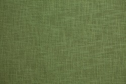 Dark green background from a textile material with wicker pattern, closeup. Structure of the olive fabric with natural texture. Cloth backdrop.
