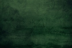 Dark green canvas grungy background or texture