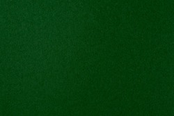 Dark green deep color with gradient paper texture. Minimalistic natural background