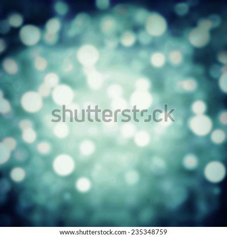 Dark green Festive Christmas background. Abstract night twinkled bright background with bokeh defocused silver lights