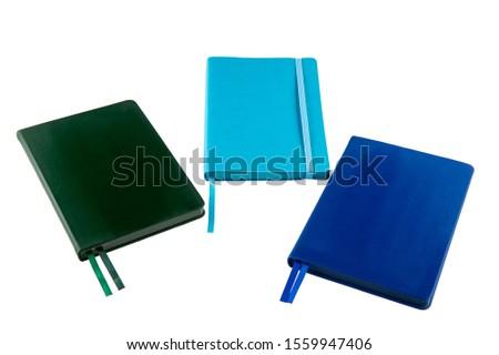 Dark green notebook, blue notebook and blue notebook #1559947406
