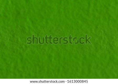 Dark green painted wall. Wall painted dark color. Green background. Dark green background. Dark green illuminated digital paper. Plain color with texture