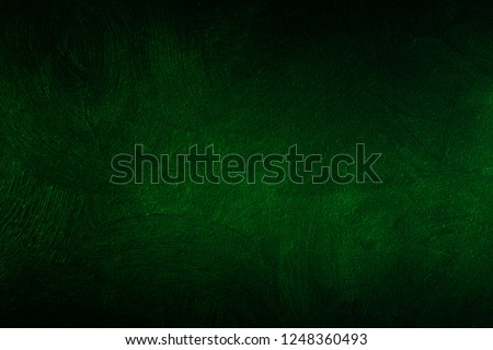 Dark green wall texture for designer background. Artistic plaster. Rough lighted surface. Abstract pattern. Bright backdrop. Raster image.