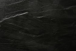 Dark grey and black slate background or texture. Flat lay top view copy space.