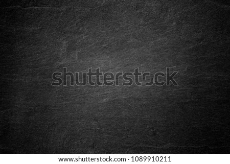 Dark grey black slate background or natural stone texture. #1089910211